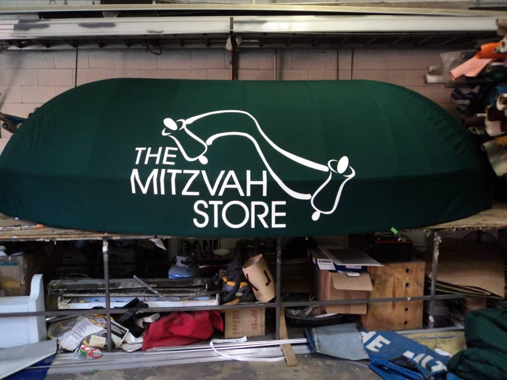 Green The Mitzvah Store Awning